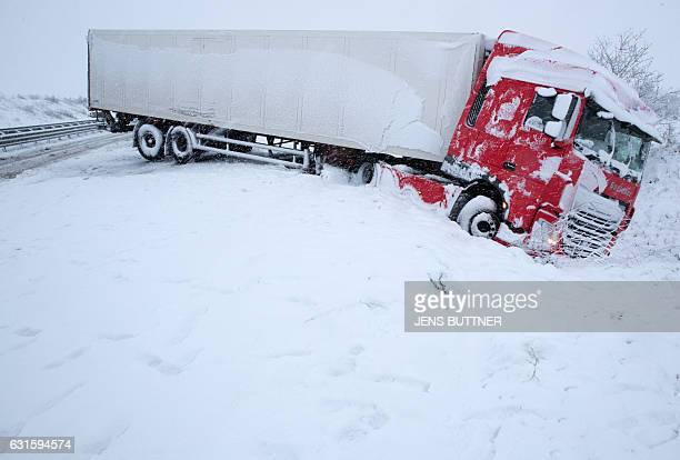 TOPSHOT A truck is pictured in the road trench of the A14 highway near Cambs in MecklenburgWest Pomerania northern Germany on January 13 2017 Strong...