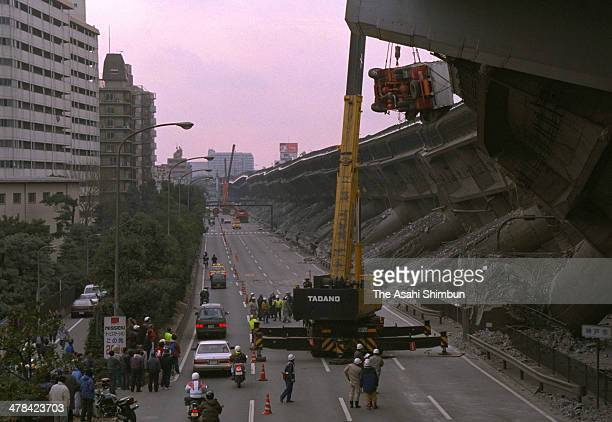 A truck is removed from the collapsed Hanshin Expressway elevated highway on Janaury 18 1995 in Kobe Hyogo Japan Magnitude 73 strong earthquake...