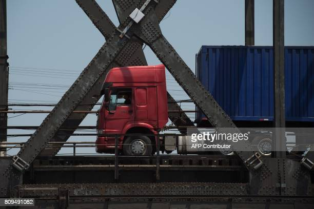 A truck is seen crossing the Friendship Bridge from North Korea's Sinuiju over to the Chinese border city of Dandong over the Yalu river in the...