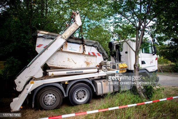 Truck is seen in the cordoned off area during a search in a garden allotment in the northern German city of Hanover on July 29 in connection with the...