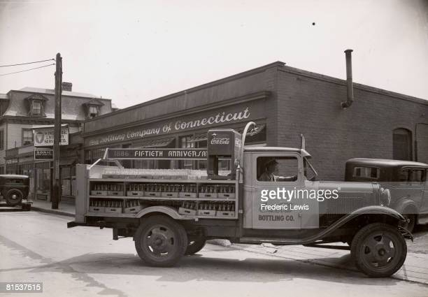 A truck laden with bottles leaves the CocaCola Bottling Company of Connecticut premises on the 50th anniversary of the product 1936