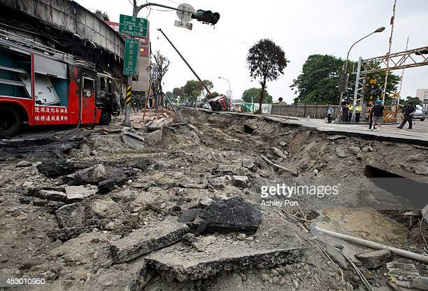 Truck lies on the damaged road after gas explosions in southern Kaohsiung on August 1, 2014 in Kaohsiung, Taiwan. A series of powerful gas blasts...