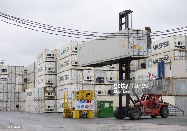 Truck lifts a refrigerated shipping container at Hunt Refrigeration in Montreal, Quebec, Canada, on Friday, Aug. 21, 2020. A strike at the Port of...