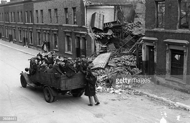 Truck load of evacuees leaving the East End of London for the country, to avoid German bombing raids. Picture Post - 297 - The East End At War - pub....