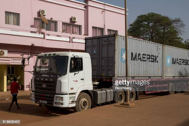 A truck loaded with AP MollerMaersk A/S branded shipping containers stands parked in Bissau GuineaBissau on Monday Feb 12 2018 The International...