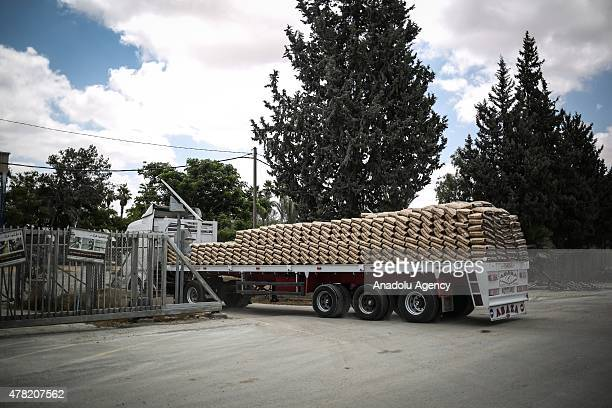 A truck loaded with construction materials crosses into Gaza from the Rafah border crossing on the border between Egypt's Sinai and the Gaza Strip on...