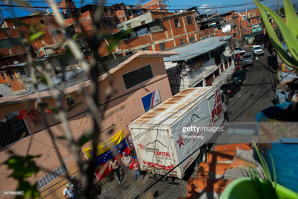 A truck loaded with groceries from the government sits in the Catia neighborhood on the outskirts of Caracas, Venezuela, on Saturday, July 2, 2016. In an attempt to regain control, President Nicolas Maduro has tapped loyal neighborhood groups, called Local Committees for Supply and Production (CLAPs), and put them in charge of distributing as much as 70 percent of the nation's food. Photographer: Manaure Quintero/Bloomberg via Getty Images