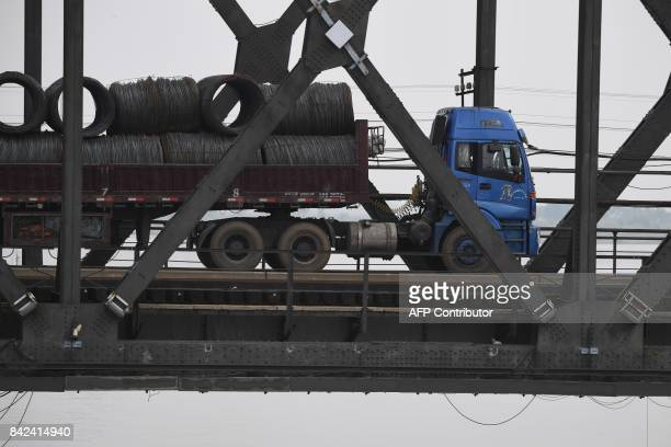 A truck loaded with steel cables makes its way across the Friendship Bridge from the Chinese border city of Dandong in China's northeast Liaoning...