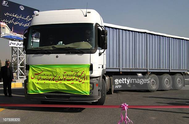 Truck loaded with the first batch of Iran's yellowcake arrives from the southern port city of Bandar Abbas at a manufacturing plant in the central...