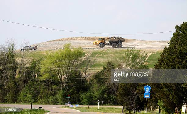 A truck moves across a large mound of coal ash carried from the site of a spill in Tennessee to a landfill in the rural largely minority community of...