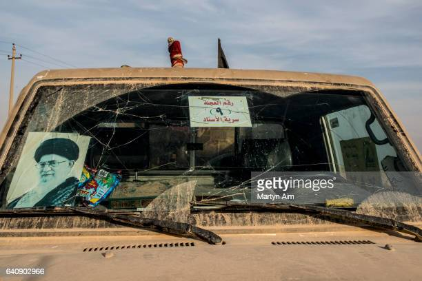 Truck of the Shia brigade Liwa al-Muntadhir featuring a portrait of Ayatollah Khomeini on the windscreen at their advance base on a frontline against...
