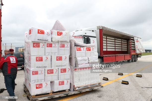 A truck of Turkish Red Crescent is seen as a military plane carrying humanitarian aid materials of Turkeys Disaster and Emergency Management...