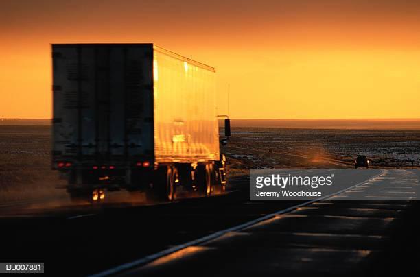 Truck on a Desert Highway at Sunset