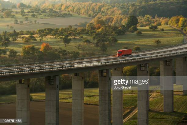 truck on autobahn bridge (dawn) - commercial land vehicle stock pictures, royalty-free photos & images