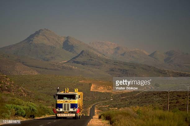 Truck on highway w/ Cederberg Mtns, S Africa