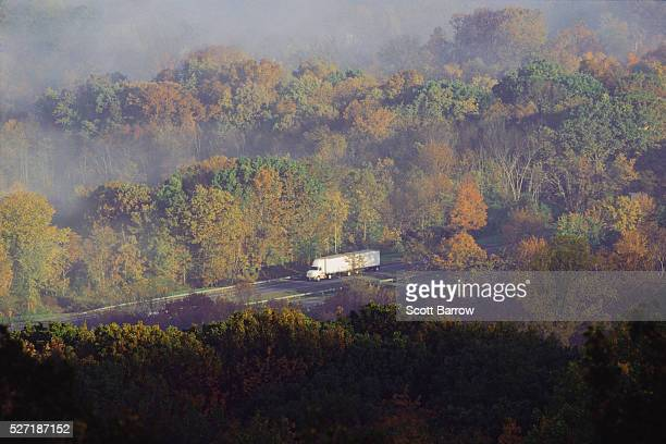 Truck on highway with fall color