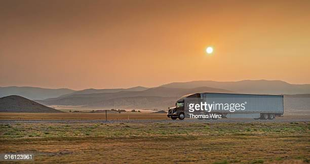 truck on i-5 at sunset - mt shasta stock pictures, royalty-free photos & images