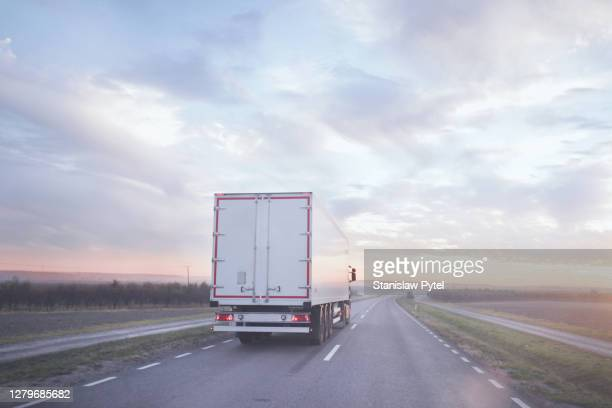 truck on road at morning - poland stock pictures, royalty-free photos & images