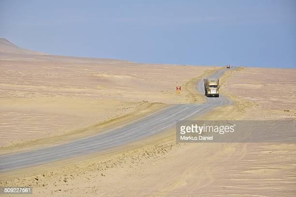 Truck on salt road in Paracas Desert, Peru