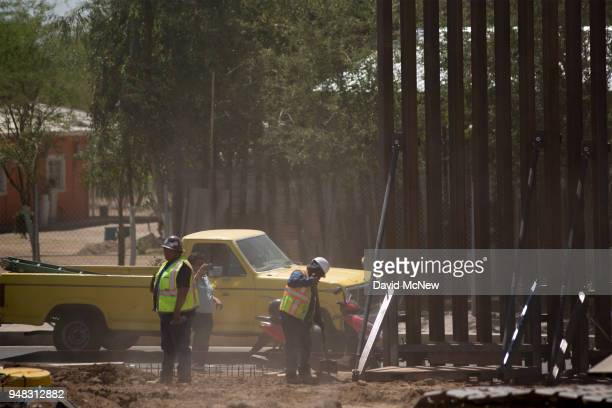 A truck on the Mexican side of the border passes as US Department of Homeland Security Secretary Kirstjen M Nielsen tours a replacement border fence...
