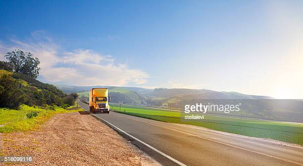truck on the road - trucking stock pictures, royalty-free photos & images