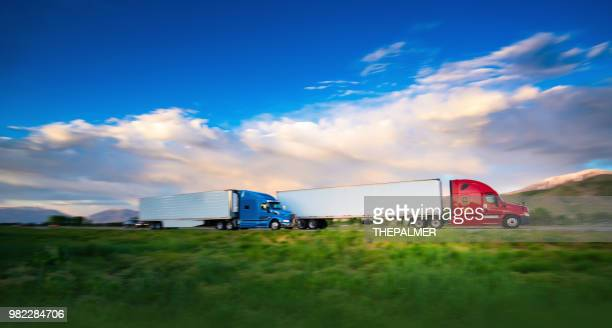 truck on the road - convoy stock pictures, royalty-free photos & images