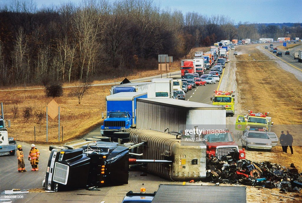Truck overturned on highway, traffic jam behind : Stock Photo