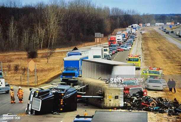 truck overturned on highway, traffic jam behind - crash stock pictures, royalty-free photos & images