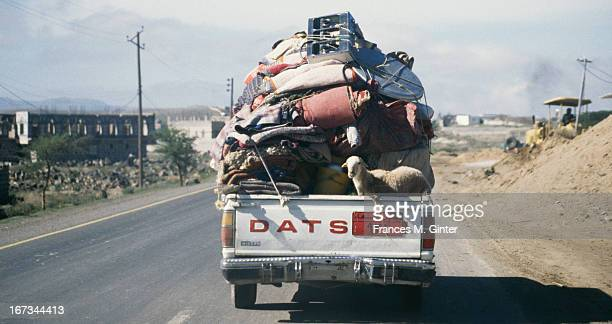 Truck packed full of blankets, housewares and a baby lamb makes it way from the village of Sana'A to Ta'Izz, Yemen, April 1995