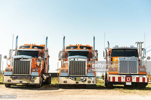 truck parked in a row - convoy stock pictures, royalty-free photos & images