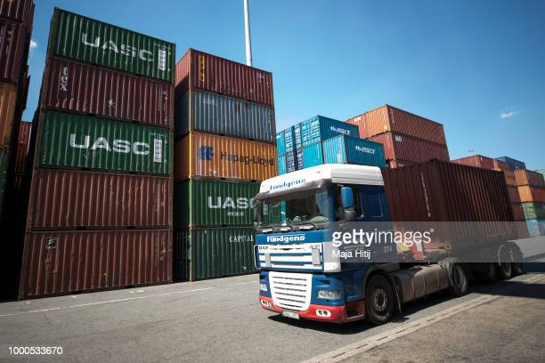 Truck pass by containers at terminal in the Duisburg port on July 16 2018 in Duisburg Germany Approximately 25 trains a week use the 'Silk Road'...