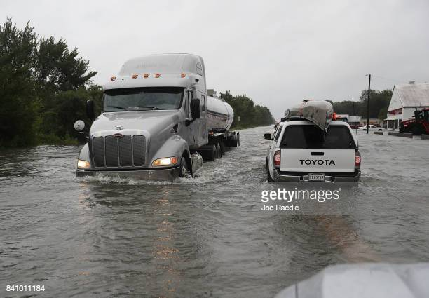 Truck pass each other along hwy 90 after parts of the road were flooded by Hurricane Harvey on August 30 2017 in Port Arthur Texas Harvey which made...