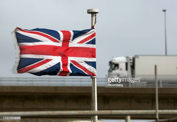 Truck passes a British Union flag, also known as a Union Jack, at the Port of Dover Ltd. In Dover, U.K., on Thursday, April 1, 2021. The U.K....