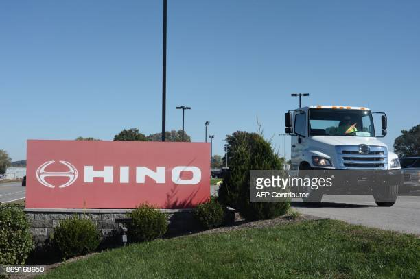 A truck passes a Hino sign in Williamstown West Virginia October 27 2017 In the smalltown heart of the industrial Ohio River basin unemployment is...