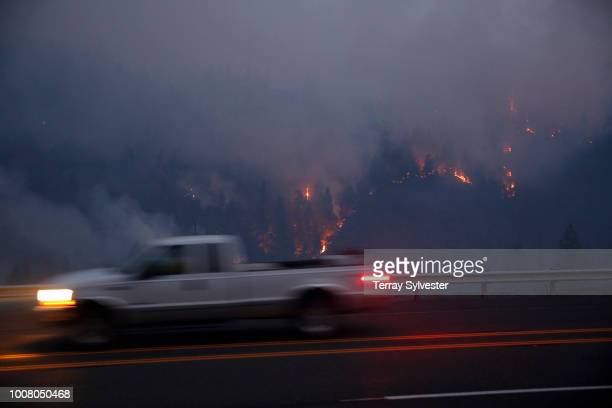 A truck passes a portion of the Carr Fire on July 30 2018 west of Redding California Six people have died in the massive fire which has burned over...