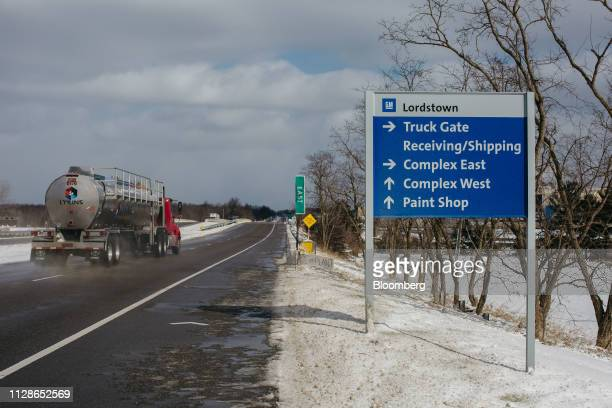 A truck passes a sign for the General Motors Co Lordstown production plant complex in Lordstown Ohio US on Monday March 4 2019 The United Auto...