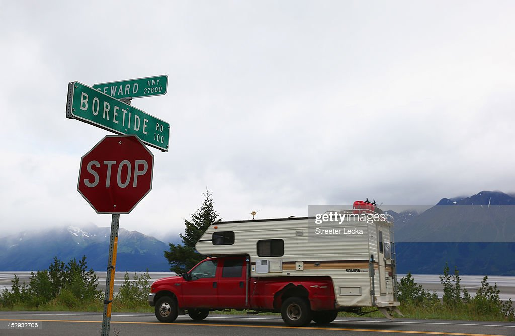 A truck passes a street sign named for the Bore Tide at Turnagain Arm on July 11, 2014 in Anchorage, Alaska. Alaska's most famous Bore Tide, occurs in a spot on the outside of Anchorage in the lower arm of the Cook Inlet, Turnagain Arm, where wave heights can reach 6-10 feet tall, move at 10-15 mph and the water temperature stays around 40 degrees Fahrenheit. This years Supermoon substantially increased the size of the normal wave and made it a destination for surfers.
