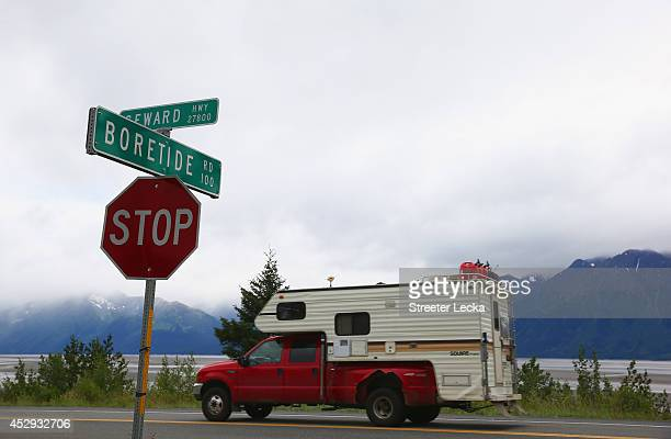 A truck passes a street sign named for the Bore Tide at Turnagain Arm on July 11 2014 in Anchorage Alaska Alaska's most famous Bore Tide occurs in a...