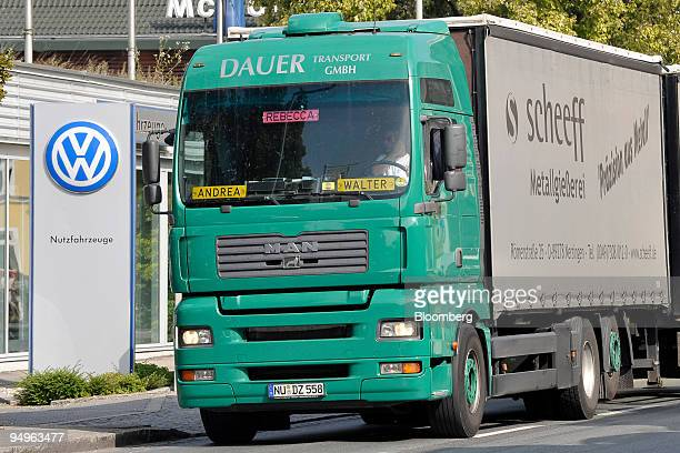 MAN truck passes a Volkswagen dealership in Ingolstadt Germany on Wednesday Sept 28 2009 MAN SE Europe's thirdlargest truckmaker is seeking...