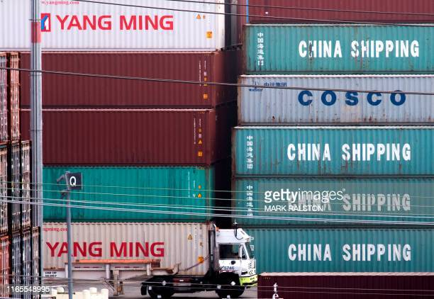 Truck passes by China Shipping containers at the Port of Los Angeles, after new tariffs on Chinese imports was imposed by President Trump, in Long...