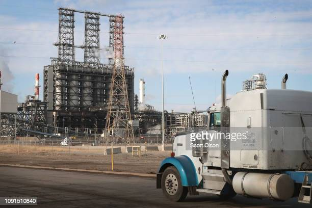 A truck passes by the BP refinery on January 08 2019 in Whiting Indiana Despite the closing of a large number of coalfired power plants carbon...