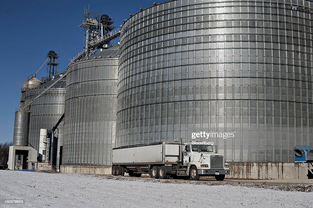 A truck passes in front of a grain storage bin at an Archer-Daniels-Midland Co. (ADM) grain elevator in Niantic, Illinois, U.S., on Tuesday, Nov. 12, 2013. Archer-Daniels-Midland Co. procures, transports, stores, processes, and merchandises agricultural commodities and products as well as processes oilseeds, corn, milo, oats, barley, peanuts, and wheat. Photographer: Daniel Acker/Bloomberg via Getty Images