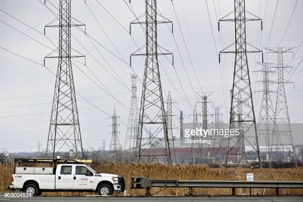 A truck passes in front of transmission towers near the NRG Energy Inc Will County Generating Station a coalfired power plant in Romeoville Illinois...