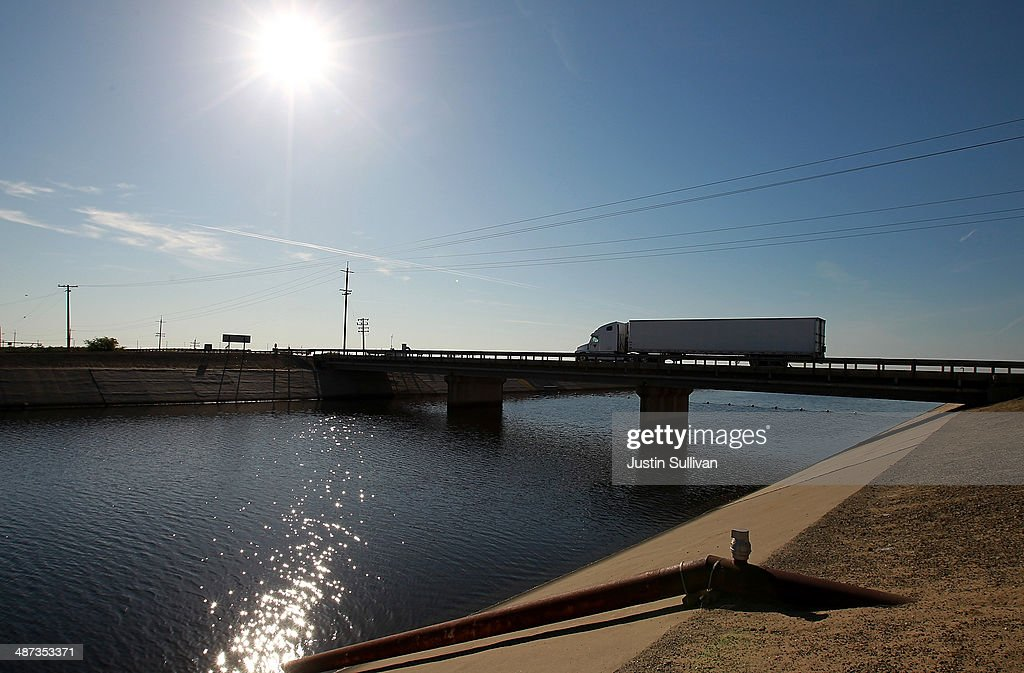 A truck passes over the San Luis Canal on April 29, 2014 near Mendota, California. As the California drought continues, Central California farmers are hiring well drillers to seek water underground for their crops after the U.S. Bureau of Reclamation stopped providing Central Valley farmers with any water from the federally run system of reservoirs and canals fed by mountain runoff.