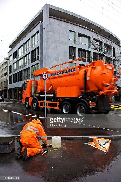 Truck passes the building that houses the headquarters of Xstrata Plc in Zug, Switzerland, on Monday, March 19, 2012. Glencore International Plc...