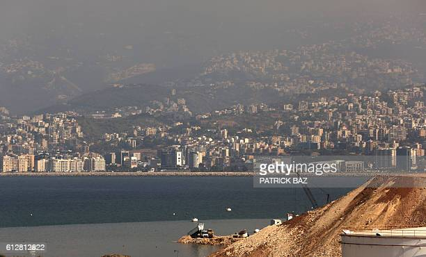 A truck pours earth into the Mediterranean sea to extend the closed Bourj Hammoud land fill on the outskirts of the Lebanese capital Beirut on...