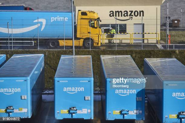A truck pulling an Amazon Prime branded cargo container waits beside the entrance gate at Amazoncom Inc's new fulfillment center in Kolbaskowo Poland...