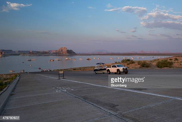 A truck pulls a boat on a trailer at the Wahweap Marina on Lake Powell in Page Arizona US on Wednesday June 24 2015 Due to severe drought Lake Powell...