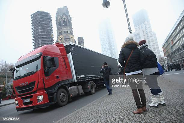 A truck pulls the trailer of a truck that yesterday drove into a crowded Chritmas market near the crime scene in the city center on December 20 2016...