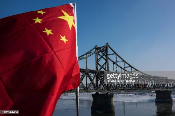 A truck returns over the Friendship Bridge from the North Korean town of Sinuiju to the Chinese border city of Dandong in China's northeast Liaoning...